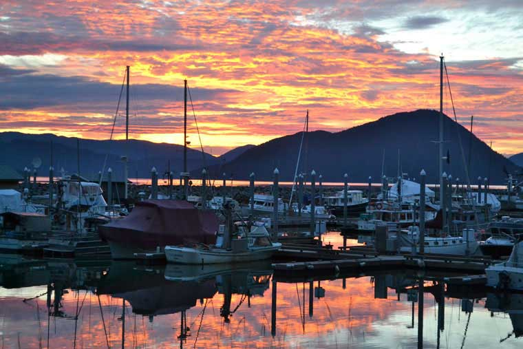 A boat harbor in Wrangell with a glorious sunset in the background © Angie Eldred / Alaska Marine Highway System
