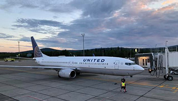 photo United Airlines jet parked at FAI
