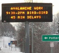 Sign warning of delays due to avalanche